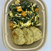 Scrambled eggs with spinach and sweet potatoes along with zucchini chicken sausage